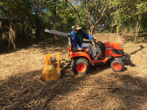 Andrew on the mulcher and getting rid of the lantana